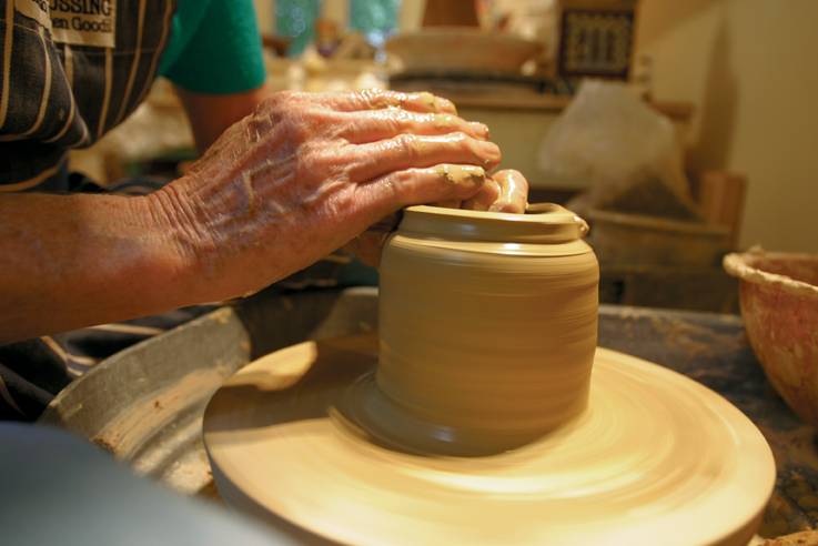 The Lady Of Castles:  Clay artist's magical hands and wheel create enchanting copulas and world-class wonders