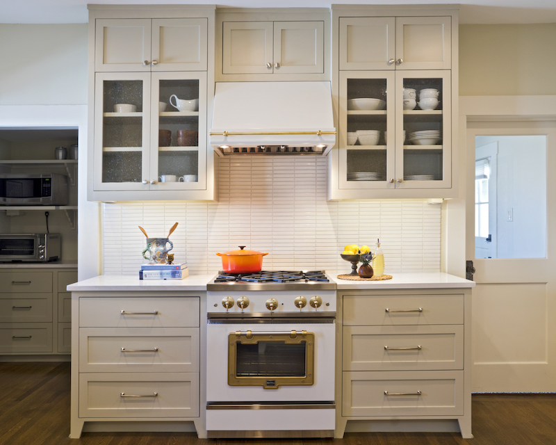 A scullery just off of the kitchen keeps small appliances on countertops for daily use, but out of sight. Backsplash tile from Fireclay. Cabinet and door hard-ware from Alexander Marchant. Range from Big Chill.