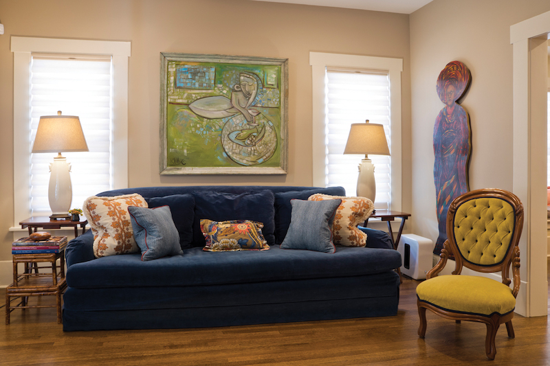 Anchoring the living area is a Karl Lubbering painting and a Robert Wurzbach painting on panel that gave visual inspiration for the Schumacher fabric plush overstuffed pillows on the Prussian blue velvet sofa.