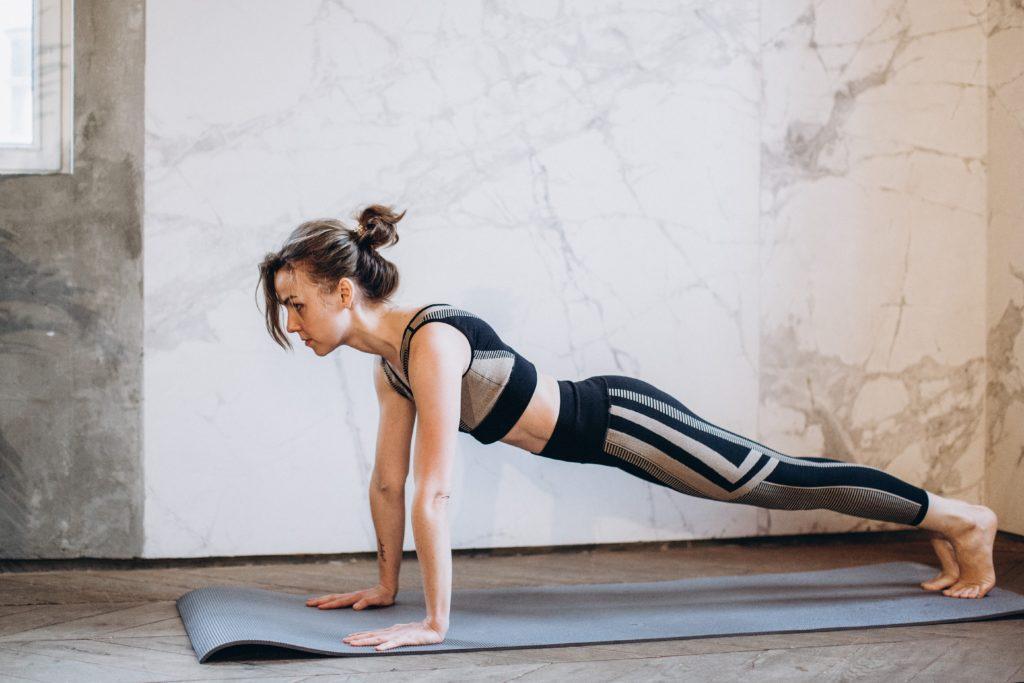 woman in black tank top and black leggings doing yoga 3822365